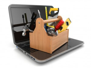 Online support. Laptop and toolbox on white isolated background. 3d